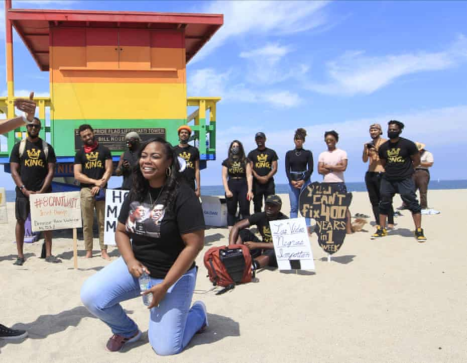 Lora King, Rodney King's daughter, kneels as she addresses supporters at at a Black Lives Matter protest in the Venice Beach area of Los Angeles last year.