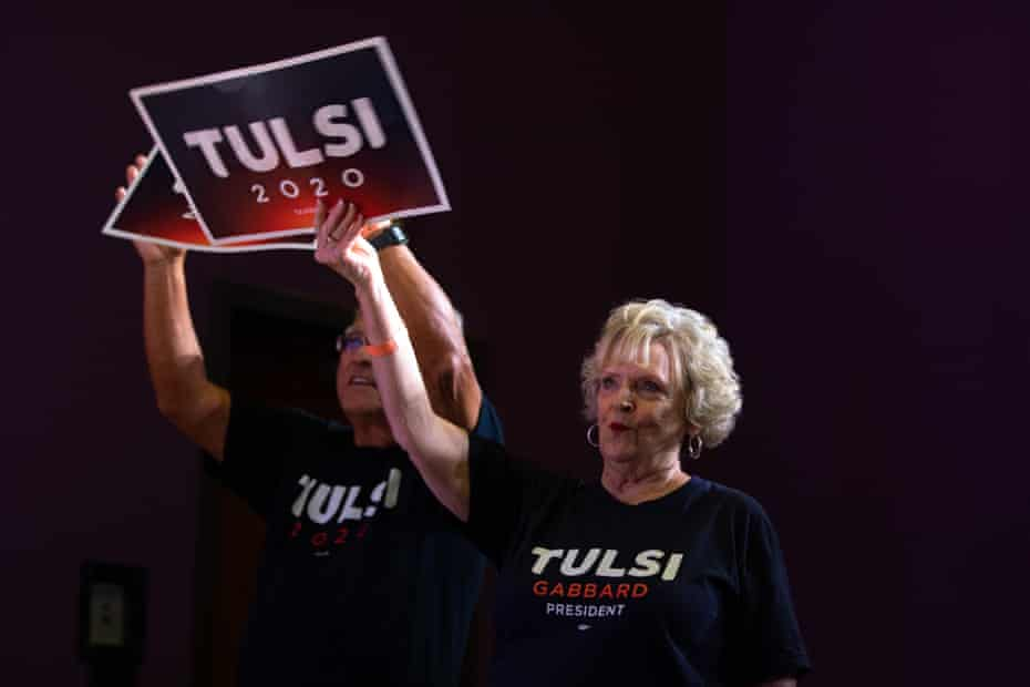 Tulsi Gabbard supporters hold campaign signs in Columbia, South Carolina, on 27 October.