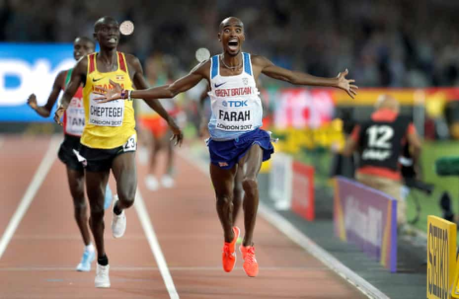 Mo Farah crosses the line to win the 10,000m final.