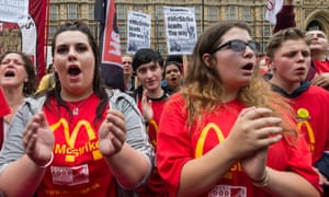 Striking McDonald's workers hold a rally outside parliament, London.