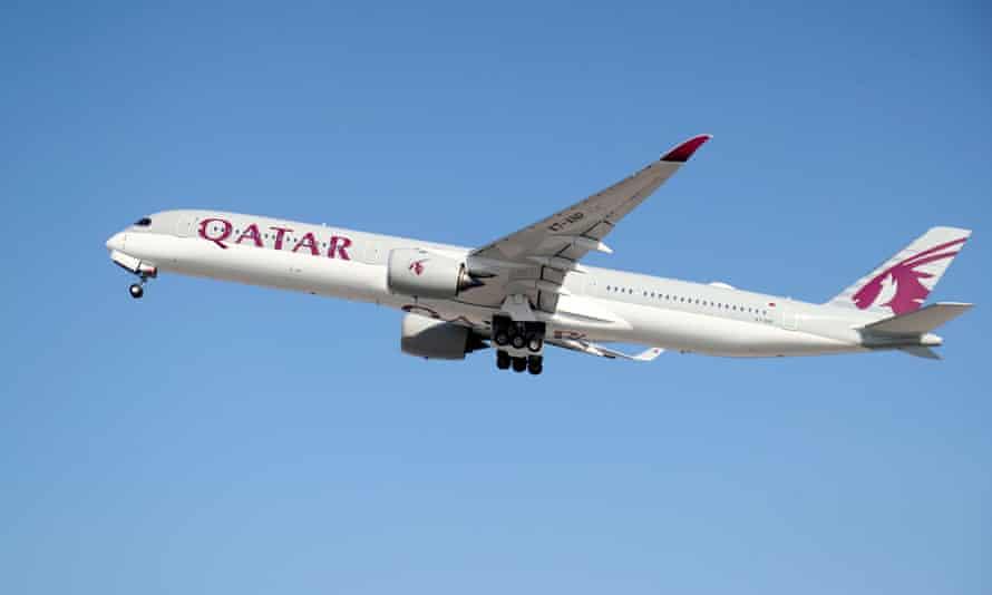 A Qatar Airways plane takes off.