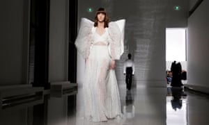 A Givenchy model with a backpack with angel wings