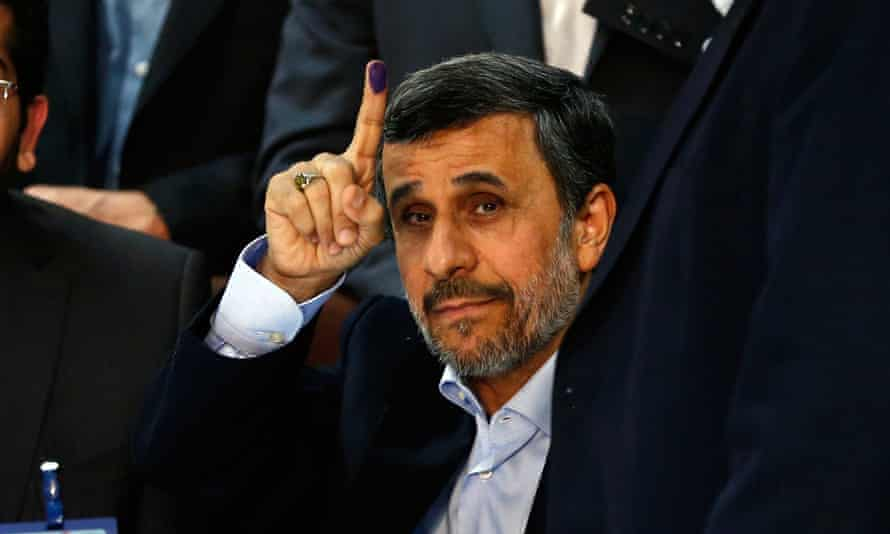 Former Iranian president Mahmoud Ahmadinejad shows his inked finger after registering his candidacy at the interior ministry in Tehran for the forthcoming election.