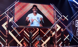 Marcus Rashford (left) is interviewed by Gabby Logan (centre) and Gary Lineker during BBC Sports Personality of the Year 2020.