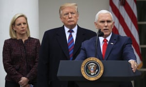 Donald Trump joined by homeland security secretary Kirstjen Nielsen, left, listens to vice-president Mike Pence during a media briefing.