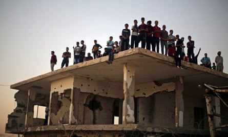 Palestinians on a damaged building at the Rafah border crossing in southern Gaza, 2017