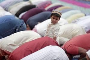 Child amid kneeling worshippers