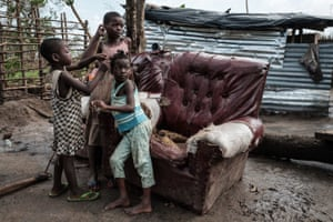 Children play in front of a house destroyed by the cyclone in Beira