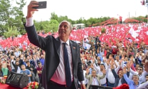 Muharrem İnce takes a selfie with supporters at an election rally in Diyarbakir.