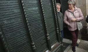 Churchgoers go through the doorway in Wittenberg where Martin Luther nailed his 95 theses