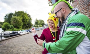 People playing the new game Pokémon Go on their smartphone in Leerdam, The Netherlands.