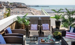 Up on the roof: the terrace, with Hastings pier in the distance.