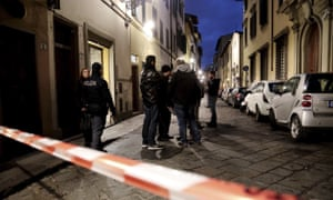 Italian police officers outside the apartment in Florence where Ashley Olsen was found dead.