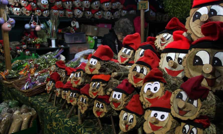 Caga Tio logs on sale at a stall at Fira de Santa Llúcia Christmas Market, Barcelona.