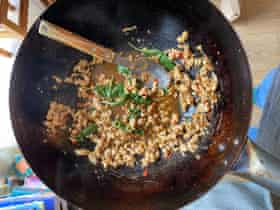 Leela Punyaratabandhu's pad kra pao: don't even thinkof leaving out Thai holy basil. Thumbs by Felicity.