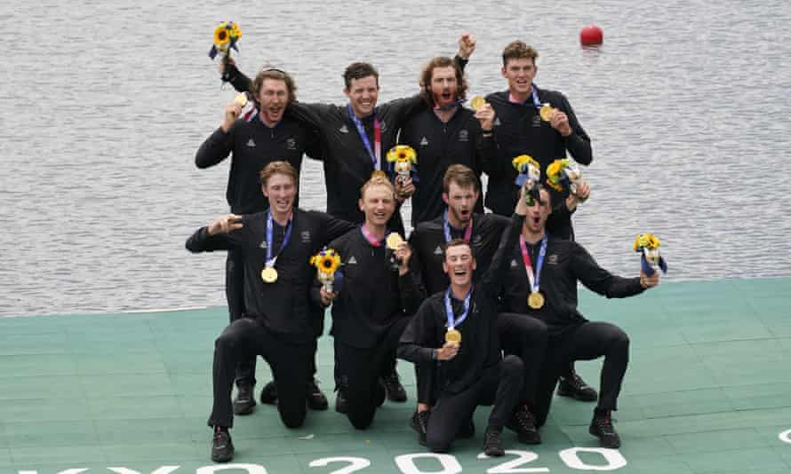 New Zealand celebrate winning the gold medal in the men's rowing eight final.