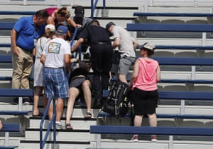 A fan down on a staircase has ice placed on their chest as temperatures rose to 98 F (37 C) with a heat index of 107 F (41 C) during the second day.