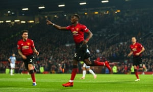 Paul Pogba celebrates scoring Manchester United's second goal against Huddersfield.