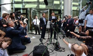 Sir Cliff Richard (centre) with his lawyer, Gideon Benaim, outside the Rolls Building in London.