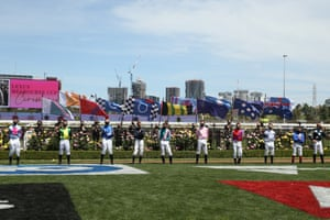Jockeys standing a safe distance from each other