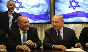 Benjamin Netanyahu, right, and Avigdor Lieberman signing their coalition deal in May 2016.