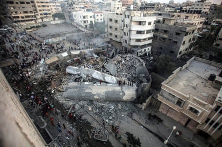 Palestinians gather at the destroyed cultural centre.