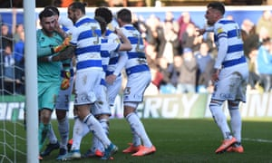 Queens Park Rangers goalkeeper Liam Kelly is mobbed by team mates after saving the penalty of Leeds United's Patrick Bamford.