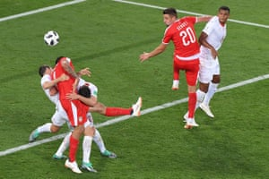 Serbia's forward Aleksandar Mitrovic is held down.