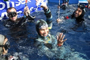 Natalia Molchanova celebrates winning the first women's free-diving world championship in 2005