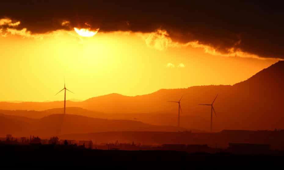 Power-generating windmill turbines at sunset near Larnaca, Cyprus.