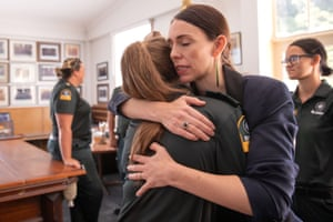 PM Jacinda Ardern meets emergency workers in Whakatane, New Zealand, after a deadly volcano eruption