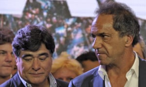 Argentina's ruling party presidential candidate Daniel Scioli, right, after he acknowledged his defeat on Sunday.