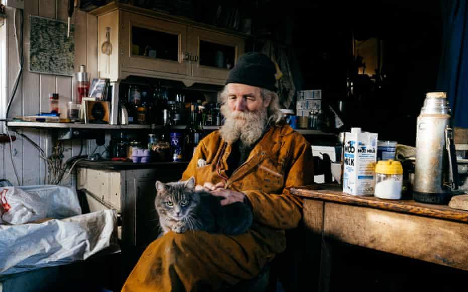 Jake Williams at home with his cat