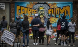 Mourners in Minneapolis, Minnesota, visit a makeshift memorial to George Floyd near the spot where he died in police custody. (Photograph: Bebeto Matthews/Associated Press)