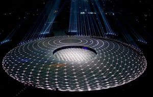 Dancers perform with lights to create geometric patterns on the Pyeongchang stage