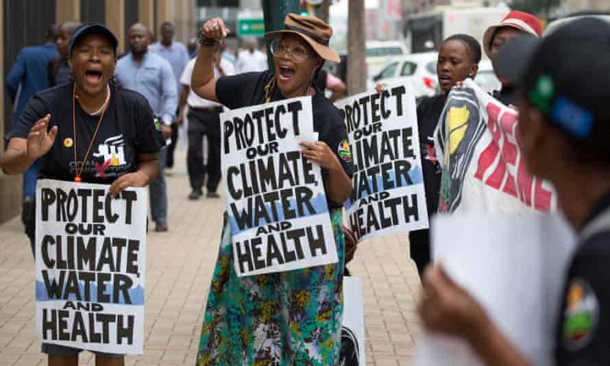 Campaigners outside South Africa's Pretoria high court during the country's first climate change lawsuit
