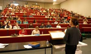 A woman teacher delivering a lecture