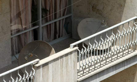 Satellite dishes such as those seen on a balcony in Tehran are widely used by Iranians to watch BBC news.