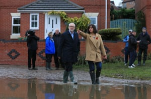 Jeremy Corbyn and Labour's candidate for Don Valley Caroline Flint view the aftermath of flooding in Conisborough, near Doncaster.