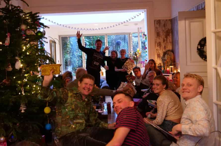 Peter Hanington (left) with friends and family at Christmas, in a snapshot taken by Ayman Alhussein, a Syrian refugee who was then staying with Hanington.
