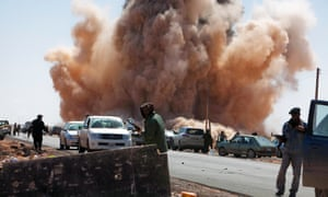 An airstrike by forces loyal to Gaddafi near a rebel checkpoint on a road outside Ras Lanuf, Libya in March 2011.