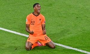 Netherlands' Denzel Dumfries celebrates scoring their third goal.