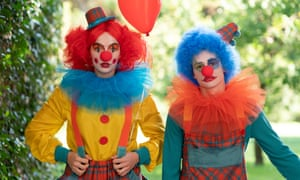Jodie Comer as Villanellle and Stefan Iancu as Felix, dressed as clowns, in a scene from the third series of Killing Eve