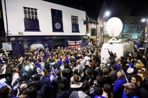 Supporters celebrate outside the Market Tavern