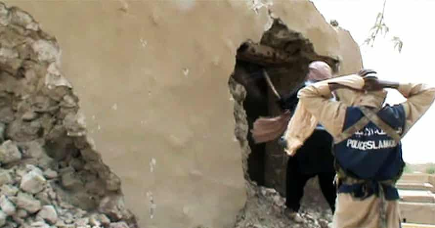 Video shows militants destroying an ancient shrine in Timbuktu.