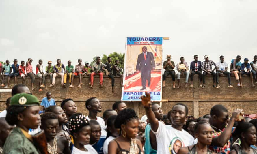 People holding the poster of Faustin-Archange Touadera, the president of the Central African Republic, at a campaign rally in Bangui, 12 December.