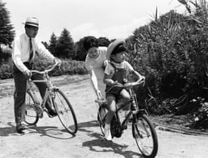 Crown Prince Akihito and Crown Princess Michiko ride bicycles with their son Naruhito in Karuizawa in Nagano in September 1965