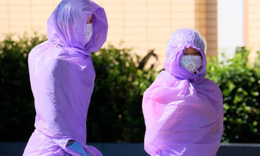 Two people in full PPE