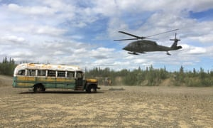 An Alaska Army National Guard helicopter prepares to remove the bus.