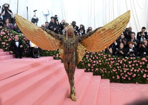 Meanwhile Billy Porter made an entrance on a litter, carried by six shirtless men, before revealing his outfit's 10-foot golden wings.